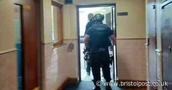Armed police arrest man after incident at block of flats