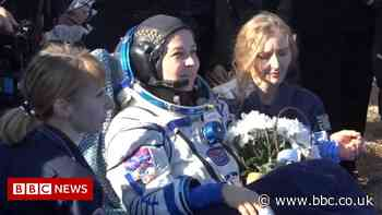 Russian team back on Earth after filming first movie in space