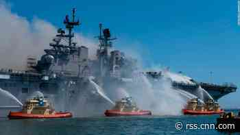 Navy investigation says fire that destroyed US warship was caused by a chain of errors and was 'clearly preventable'