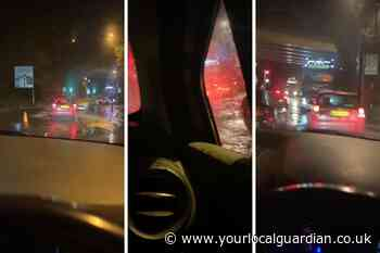Heavy rain floods Coulsdon roads as drivers struggle