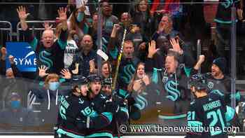 Despite an electric sell-out crowd, the Seattle Kraken fall to the Vancouver Canucks 4-2. - Tacoma News Tribune