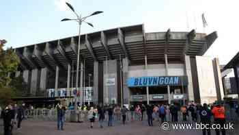 Man City fan attack: Two remain in custody after five men appear in court