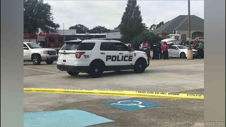 One found dead in Holiday Inn parking lot following double-shooting