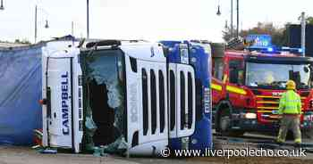 Driver in hospital after lorry overturned on busy road