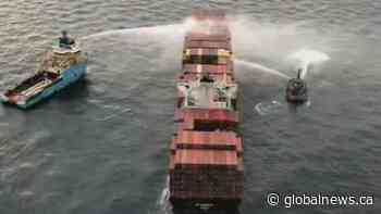 Bad weather hampers efforts to board cargo ship that caught fire in B.C.