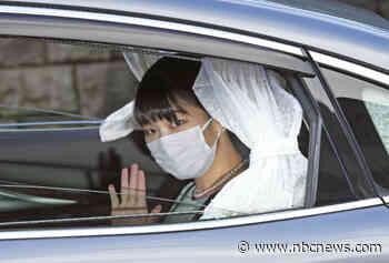 Defying public scorn and media storm, Japan's princess finally marries