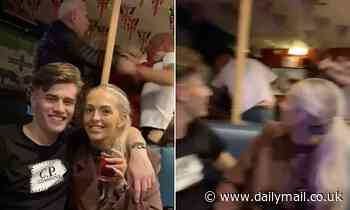 Couple are photobombed by pub brawlers as they pose for a picture [Video]