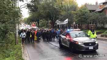 Marchers call for safer roads 2 weeks after crash near High Park kills older couple